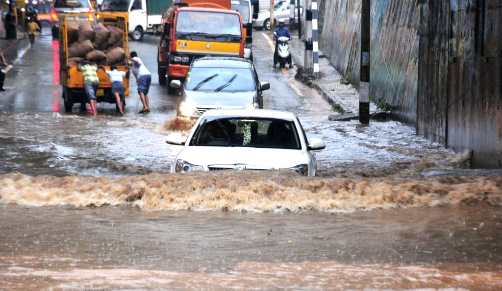 :Bengaluru: Heavy rains cause waterlogging and flooding of streets in Bengaluru on Nov. 4, 2015. (Photo: IANS).