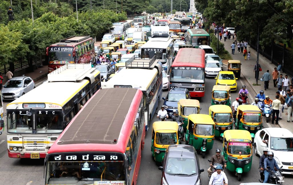 Bengaluru: Heavy traffic jam at JC Road due to protest rally by members of Vokkaliga Sangha and supporters of DK Shivakumar against his arrest by Enforcement Directorate (ED) from National College to Freedom Park, in Bengaluru on Sep 11, 2019. (Photo