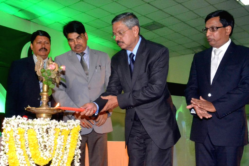 HL Dattu, Chief Justice of India with Manan Kumar Mishra, Chairman, Bar Council of India and Bhoje Gowda, Vice Chairman, Bar Council of India seen lighting lamp to inaugurate the 35th ... - Manan Kumar Mishra