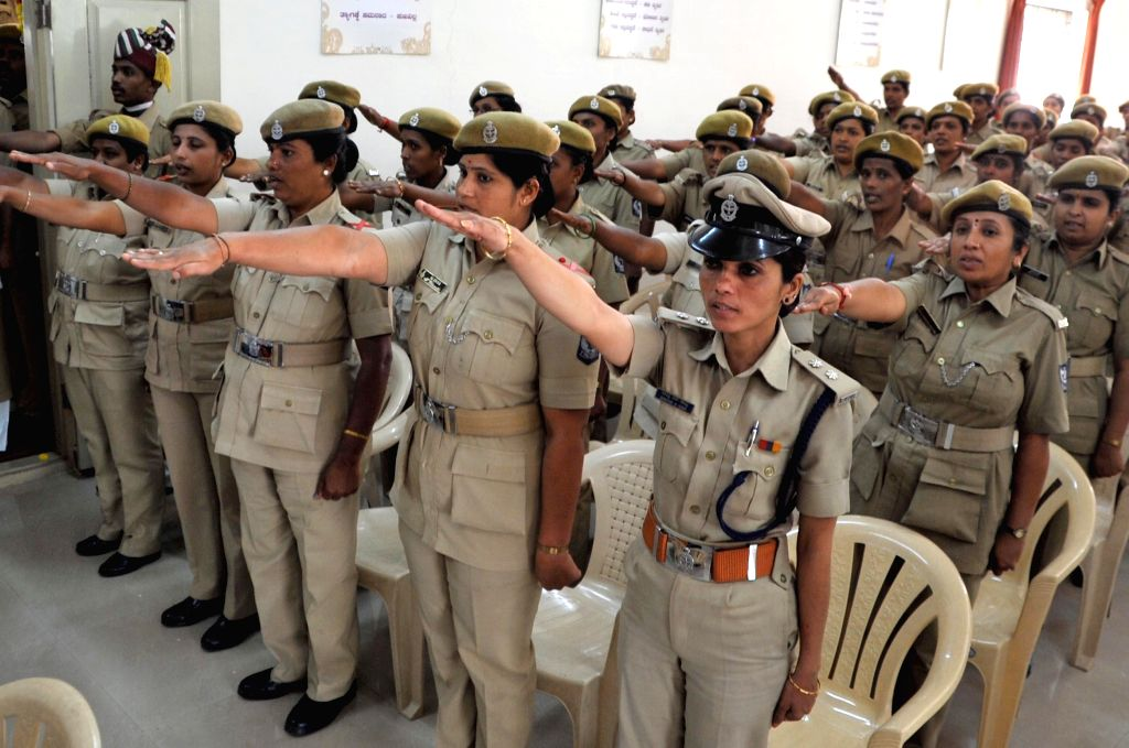 Home Guards take oath during Karnataka Home Guards' Day celebration at Gruharakshana Bhavan, in Bengaluru on Dec 25, 2014.
