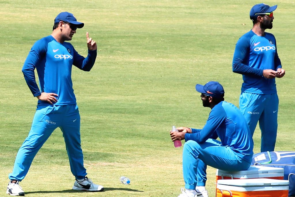 Bengaluru: India's MS Dhoni and Dinesh Karthik during a practice session ahead of the 2nd T20I match against Australia M Chinnaswamy Stadium in Bengaluru, on Feb 26, 2019. (Photo: IANS) - MS Dhoni