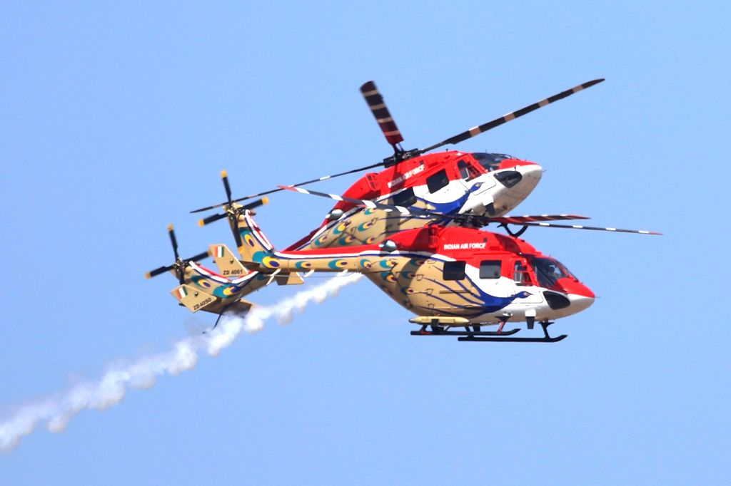 Bengaluru: Indian Air Force's (IAF) Sarang helicopters during rehearsals for AERO India 2019 at Air Force Station Yelahanka in Bengaluru on Feb 18, 2019.