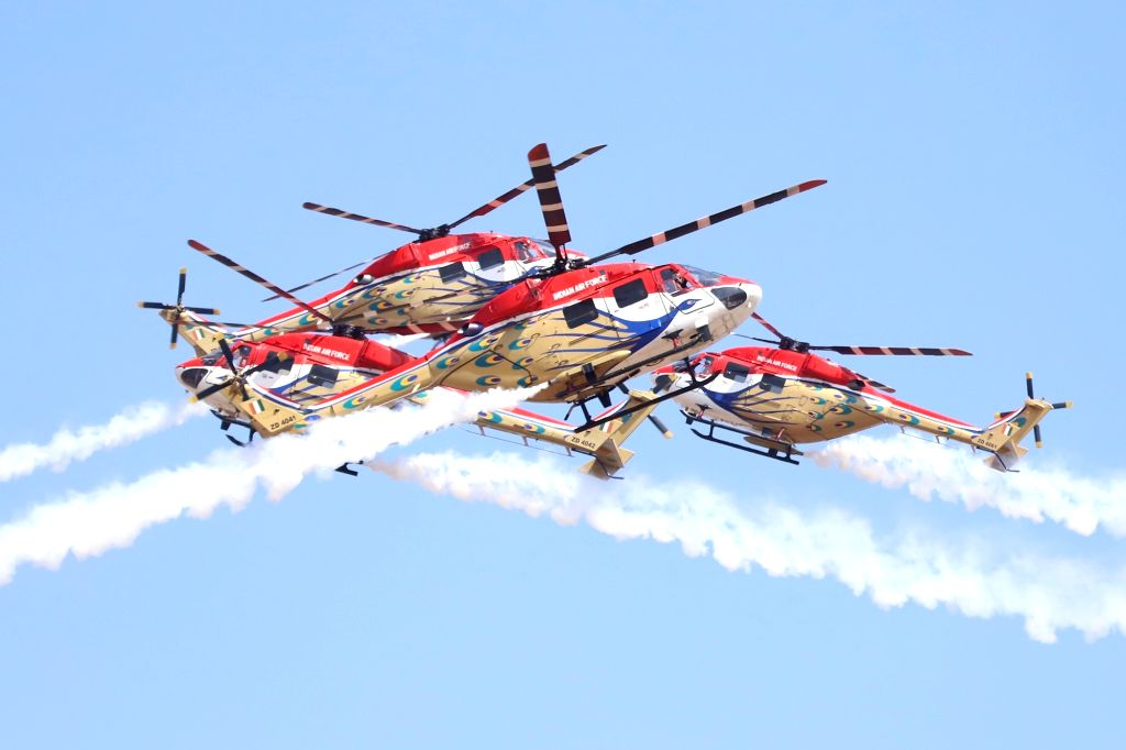 "Bengaluru: Indian Air Force's (IAF) Sarang display team enthralls audience at ""Aero India 2019"" - air show at Yelahanka Air Force Station, in Bengaluru, on Feb 20, 2019. (Photo: IANS)"