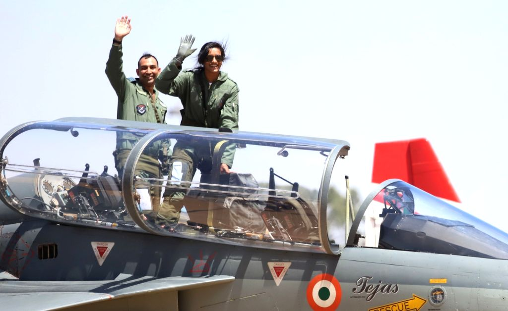 "Bengaluru: Indian badminton player PV Sindhu in the cockpit of Tejas fighter aircraft during ""Aero India 2019"" - air show at Yelahanka Air Force Station, in Bengaluru, on Feb 23, 2019. (Photo: IANS)"