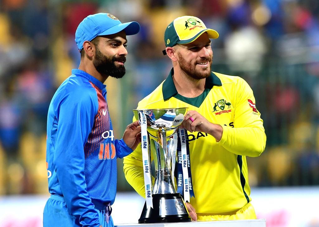 Bengaluru: Indian captain Virat Kohli and his Australian counterpart Aron Finch with the trophy ahead of the second T20I match between India and Australia at M Chinnaswamy Stadium in Bengaluru on Feb 27, 2019. (Photo: IANS) - Virat Kohli