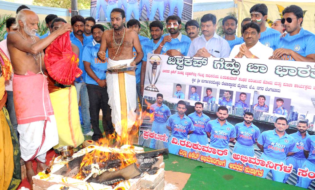 Indian fans perform yagna for the Indian cricket team in Bengaluru, on March 18, 2015.