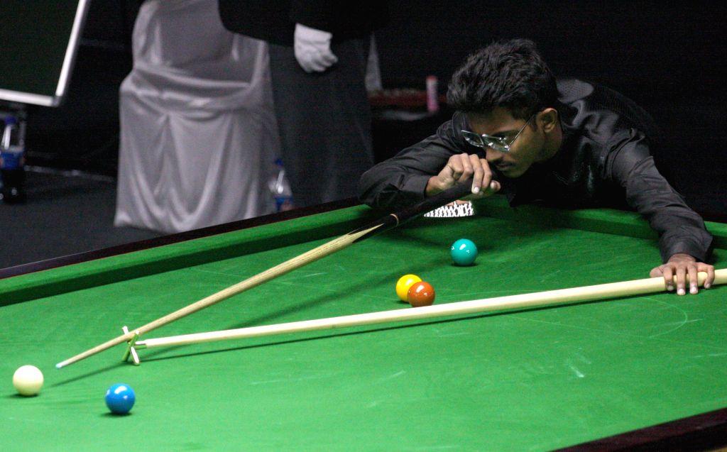 Indian player  Ashutosh Padhy in action during IBSF World Snooker Championships at  Kanteerava Stadium, in Bengaluru on Nov. 21, 2014.