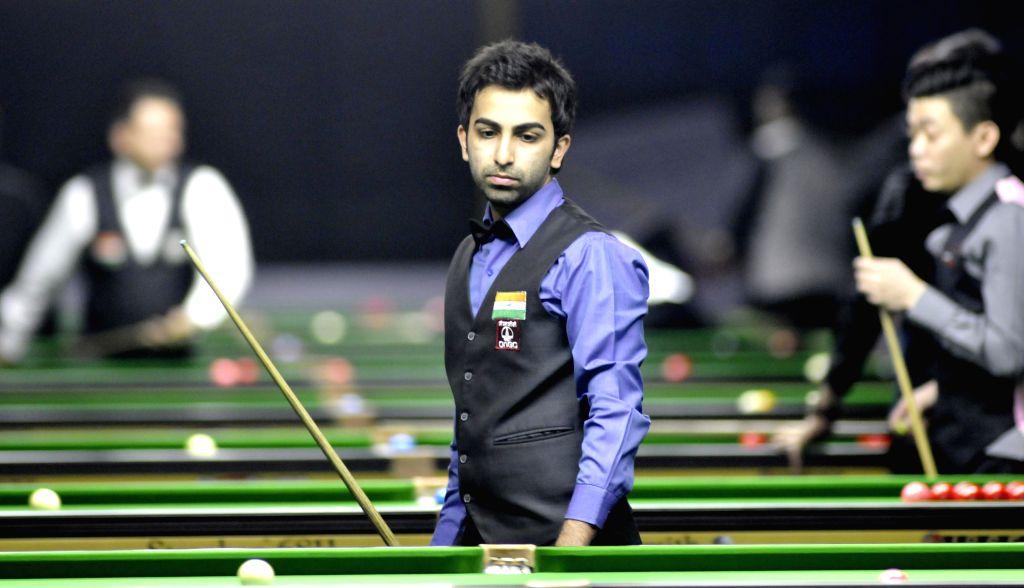 Indian player Pankaj Advani during a game of IBSF World Snooker Championship at Kanteerava Stadium, in Bengaluru on Nov. 25, 2014.