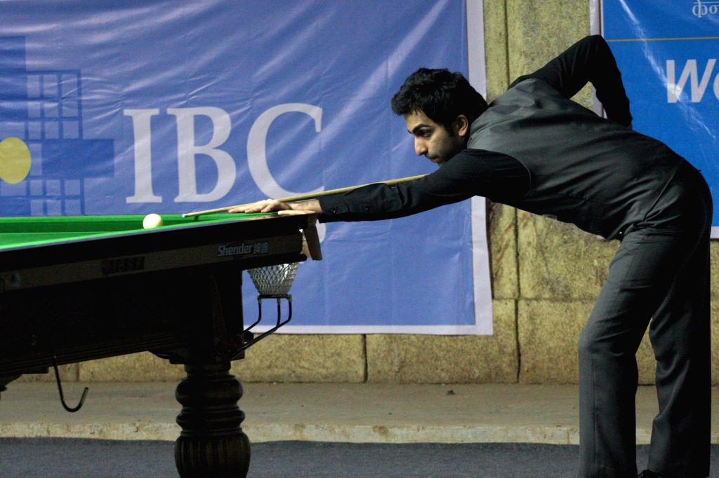 Indian player Pankaj Advani in action during IBSF World Snooker Championships at Kanteerava Stadium, in Bengaluru on Nov. 27, 2014.