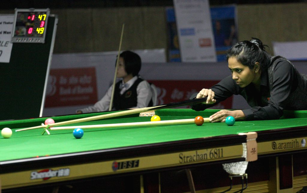 Indian player Vidya Pillai in action during IBSF World Snooker Championships at Kanteerava Stadium, in Bengaluru on Nov. 20,  2014.