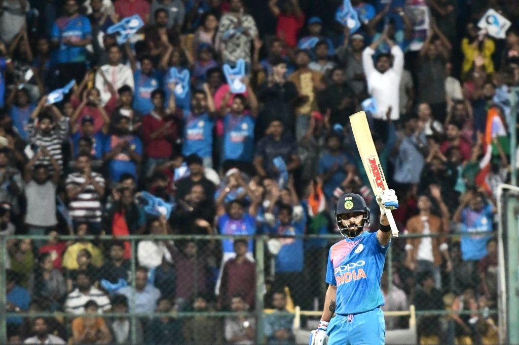 Bengaluru: Indian skipper Virat Kohli celebrates his half century during the second T20I match between India and Australia at M Chinnaswamy Stadium in Bengaluru on Feb 27, 2019. (Photo: IANS) - Virat Kohli