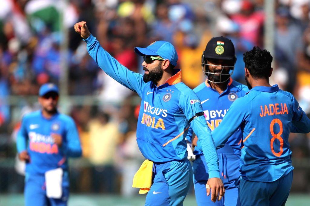 Bengaluru: Indian skipper Virat Kohli celebrates the dismissal of Mitchell Starc during the third and final ODI match between India and Australia, at M. Chinnaswamy Stadium in Bengaluru on Jan 19, 2020. (Photo: Surjeet Yadav/IANS) - Virat Kohli and Surjeet Yadav