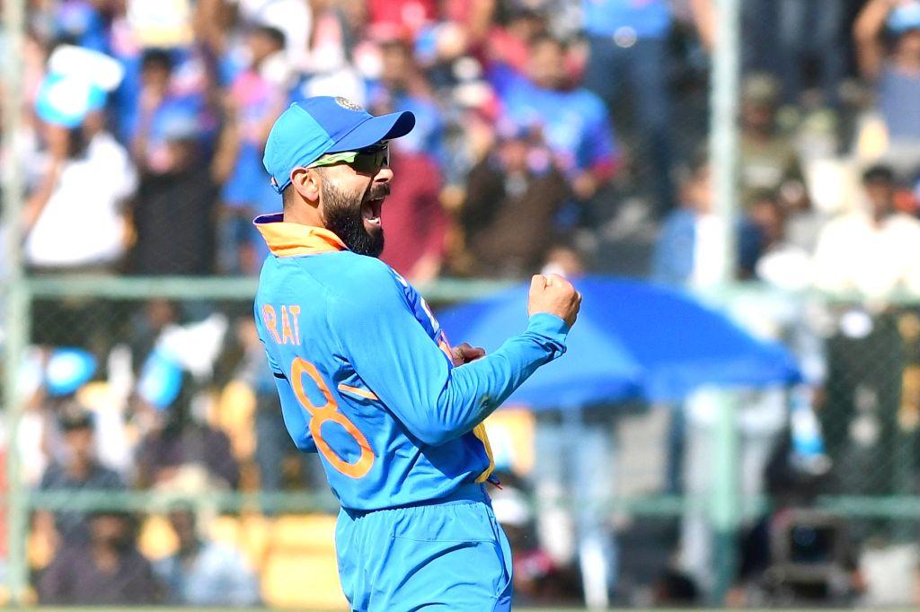 Bengaluru: Indian skipper Virat Kohli celebrates the wicket of Mitchell Starc during the third and final ODI match between India and Australia, at M. Chinnaswamy Stadium in Bengaluru on Jan 19, 2020. (Photo: IANS) - Virat Kohli