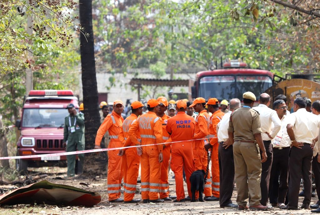 Bengaluru: Inspection underway at the site where Hawk MK 132 aircraft of Indian Air Force's Surya Kiran display team crashed after a mid-air collision while rehearsing for upcoming  'Aero India 2019' air show near the Yelahanka airbase, in Bengaluru