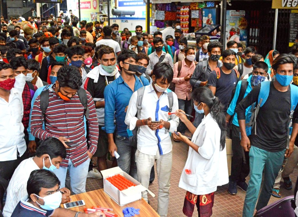 Bengaluru : Inter-state commuters waiting for COVID-19 swab test at City Railway station, amid surge in coronavirus case in Bengaluru on Tuesday, June 22, 2021