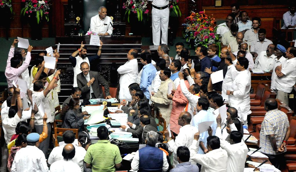 JD(S) and BJP legislators stage a protest in Karnataka Assembly to demand CBI probe in the mysterious death of Karnataka IAS officer in Bengaluru on March 18, 2015.