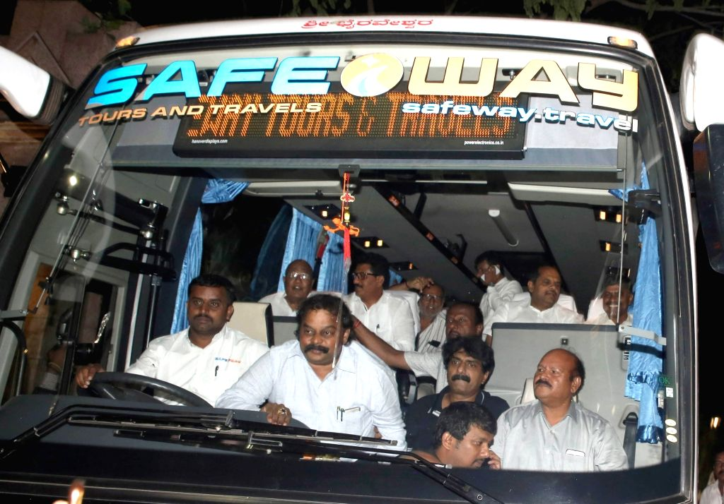 Bengaluru: JD(S) MLAs leaving in a bus from Hotel Taj West End to a resort in Kodagu following the political developments in Karnataka, in Bengaluru on July 8, 2019. (Photo: IANS)