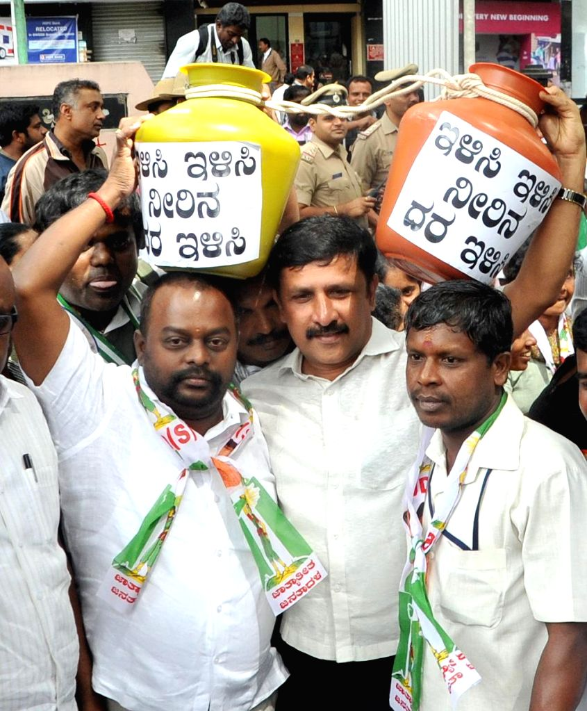 JDS workers protest against hike in water tariff, outside Water Board in Bengaluru, on Nov 5, 2014.