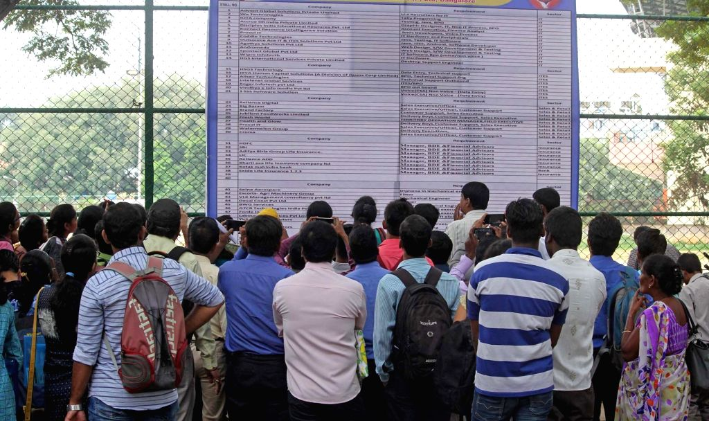 Bengaluru: Job aspirants visit a job fair organised by the NA Haris Foundation, in Bengaluru on July 24, 2017. (Photo: IANS)