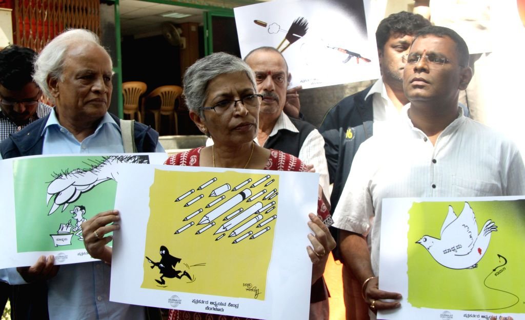 Journalists stage a protest to condemn the massacre of 12 people at the office of a French satirical magazine in Paris, at Bengaluru press club on Jan 16, 2015.