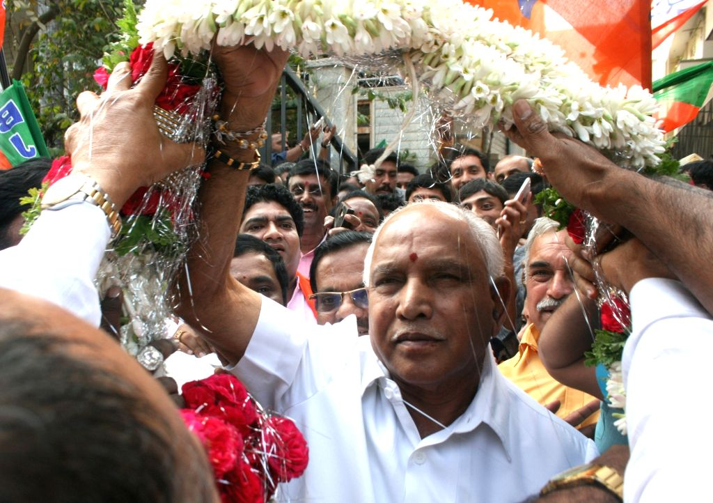 Bengaluru: Karnataka BJP president B S Yeddyurappa celebrates over party's performance in the recently concluded Himachal and Gujarat Assembly polls, in Bengaluru, on Dec 18, 2017. (Photo: IANS)