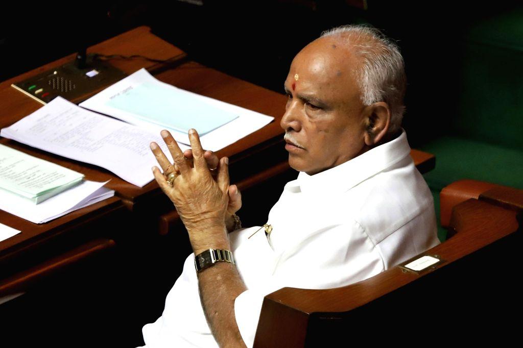 Bengaluru: Karnataka BJP President B S Yeddyurappa in the state assembly where Chief Minister HD Kumaraswamy moved motion of confidence in Bengaluru on July 18, 2019. (Photo: IANS) - H