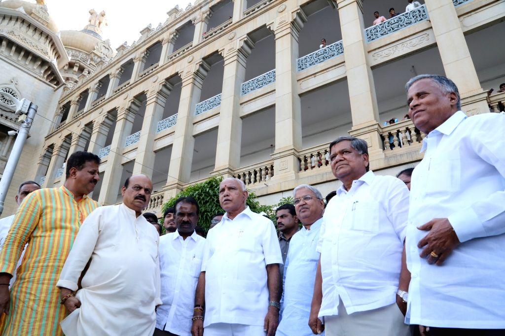 Bengaluru: Karnataka BJP President B. S. Yeddyurappa with BJP leaders at Vidhan Soudha in Bengaluru on July 15, 2019. (Photo: IANS)