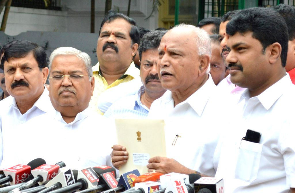 Bengaluru: Karnataka BJP President B. S. Yediyurappa talks to media personnel after meeting Governor Vajubhai Vala, in Bengaluru on July 26, 2019. The BJP on Friday staked claim to form the new government in Karnataka and urged state Governor Vajubha