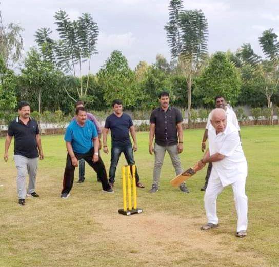 Bengaluru: Karnataka BJP President BS Yeddyurappa plays cricket with party MLAs during their resort stay in Bengaluru on July 16, 2019.