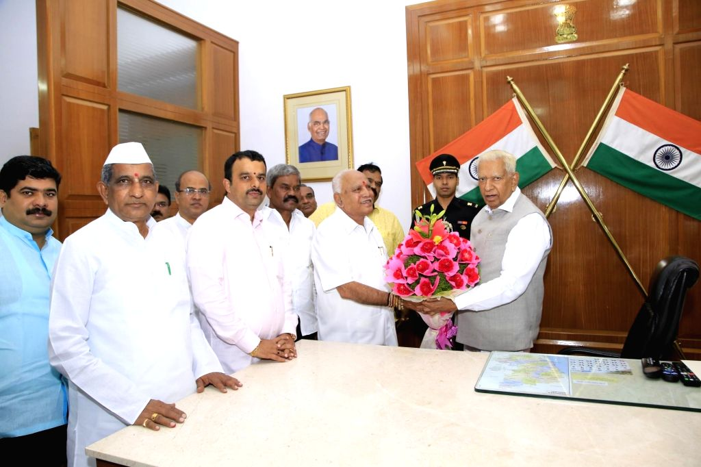 Bengaluru: Karnataka BJP president BS Yeddyurappa and BJP MLAs meeting Governor Vajubai Vala at Raj bhavana in Bengaluru on July 26, 2019.(Photo: IANS)