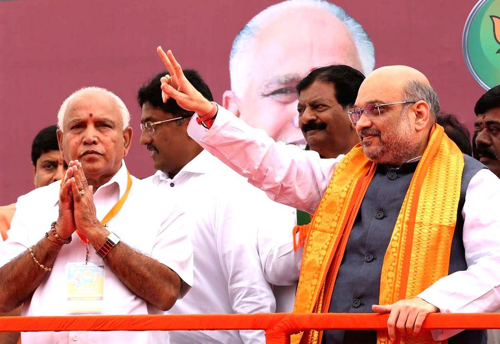 Bengaluru: Karnataka BJP State President B S Yediyurappa welcomes BJP President Amit Shah during a party rally in Bengaluru on Aug 12, 2017. (Photo: IANS) - Amit Shah