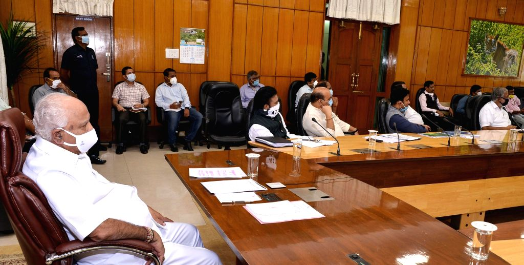 Bengaluru: Karnataka Chief Minister B. S. Yediyurappa attends a video conference meet chaired by Prime Minister Narendra Modi with the Chief Ministers of all the states to discuss the steps taken to contain the spread of Covid-19 across the country,  - B. S. Yediyurappa, B Sriramulu, Basavaraj Bommai, D Sudhakar, Suresh Kumar and Narendra Modi