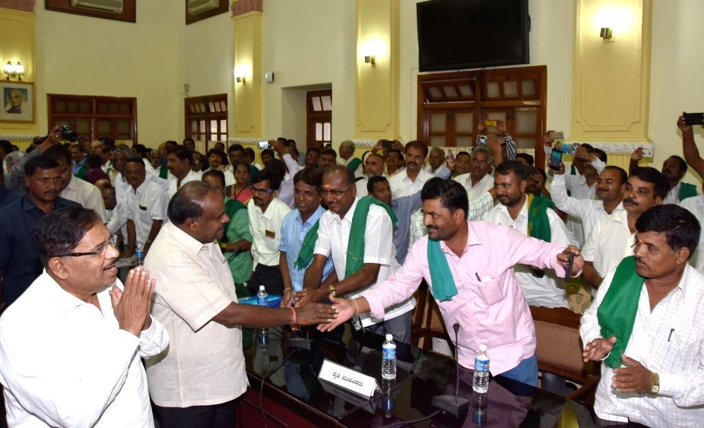 Bengaluru: Karnataka Chief Minister H.D. Kumaraswamy greets farmer representatives  who came from 30 districts during a meeting with them over loans waiver, at Vidhana Soudha in Bengaluru on ... - H.