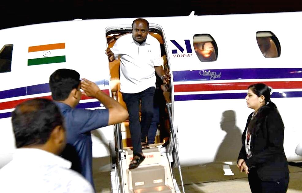 Bengaluru: Karnataka Chief Minister HD Kumarswamy arrives in a special flight at HAL Airport following political developments in Karnataka state in Bengaluru on July 7, 2019. (Photo: IANS) - H