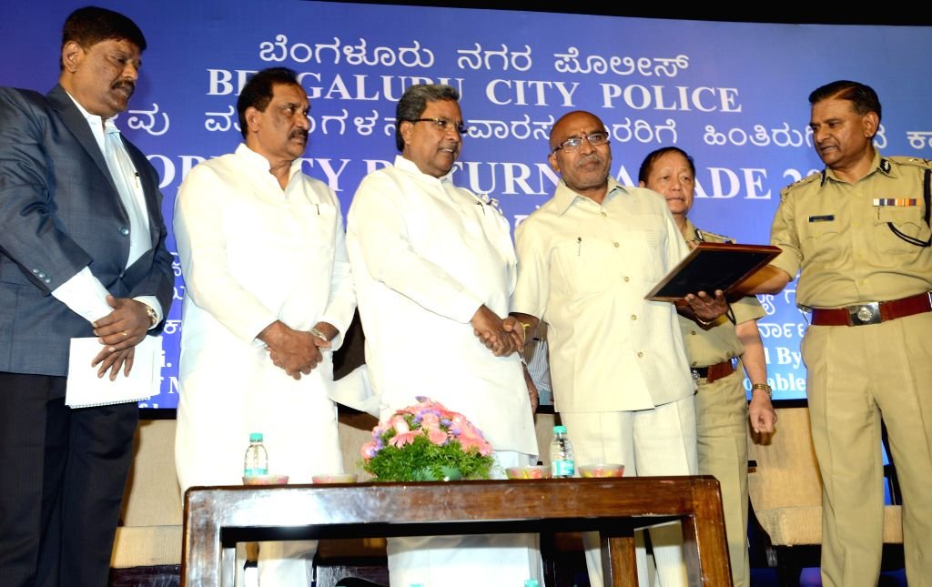 Karnataka Chief Minister Siddaramaiah during a property parade organised by Bengaluru City Police at Kanteerva Indoor Stadium in Bengaluru, on Nov 11, 2014. - Siddaramaiah