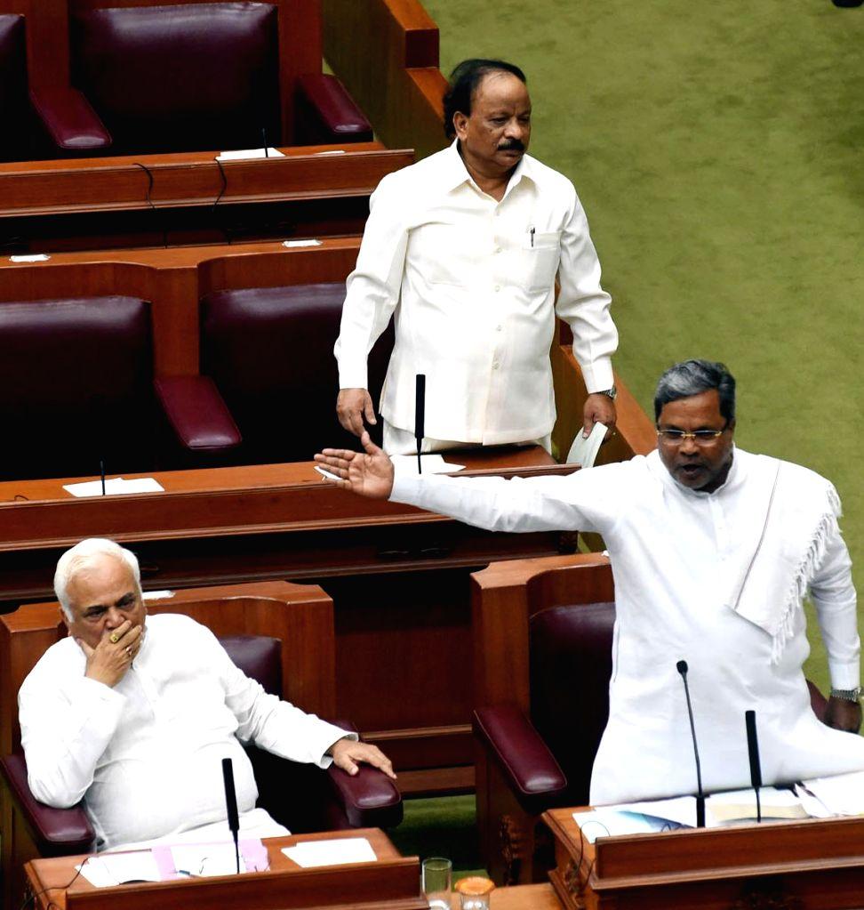 Karnataka Chief Minister Siddaramaiah addresses during the winter session of Karnataka assembly at the Suvarna Soudha in Bengaluru on Dec 9, 2014. - Siddaramaiah