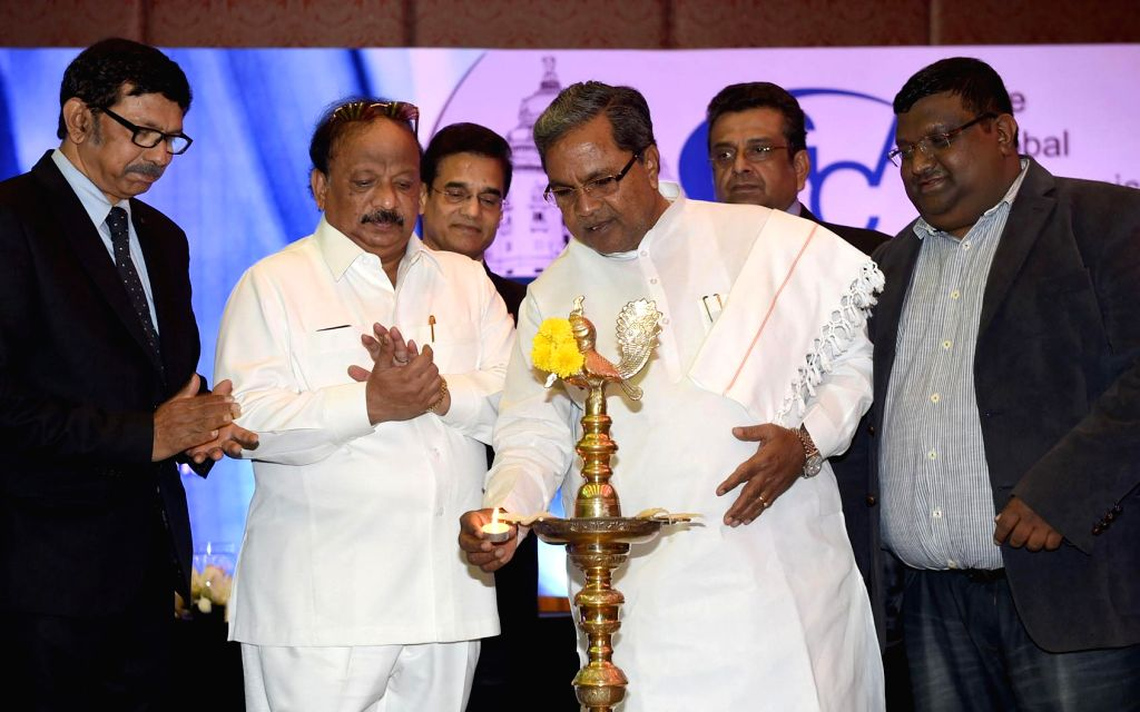 Karnataka Chief Minister Siddaramaiah during the inauguration of `The Global Communication Association 9th India Conference` in Bengaluru, on Jan 8, 2015. Also seen Minister for state R. .. - Siddaramaiah and R. Roshan Baig
