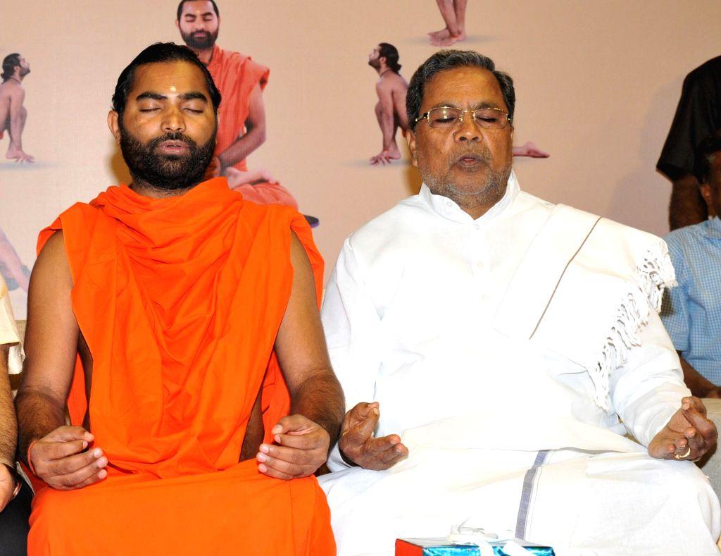 Karnataka Chief Minister Siddaramaiah performs yoga during Karnataka Yoga Abhiyana Camp, organised by Karnataka Olympics Association, at Kanteerva Indoor Stadium, in Bengaluru on Jan 10, .. - Siddaramaiah