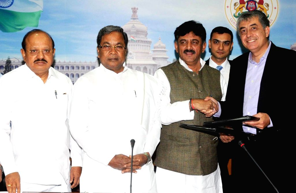 Karnataka Chief Minister Siddaramaiah with SunEdison CEO Ahmad Chatila during a programme organised to exchange MoU on fuel development in Bengaluru, on Jan 13, 2015. Also seen Karnataka .. - Siddaramaiah
