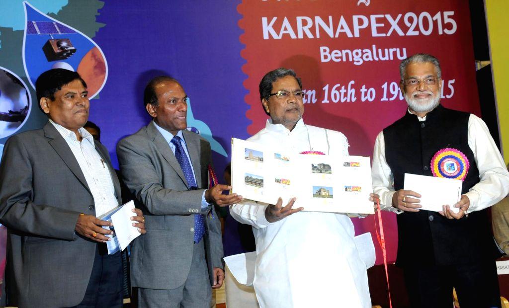 Karnataka Chief Minister Siddaramaiah releases new stamps during four-day long `KARNAPEX 2015` - a philatelic exhibition organised by Karnataka Postal Circle at Kanteerava Indoor Stadium .. - Siddaramaiah