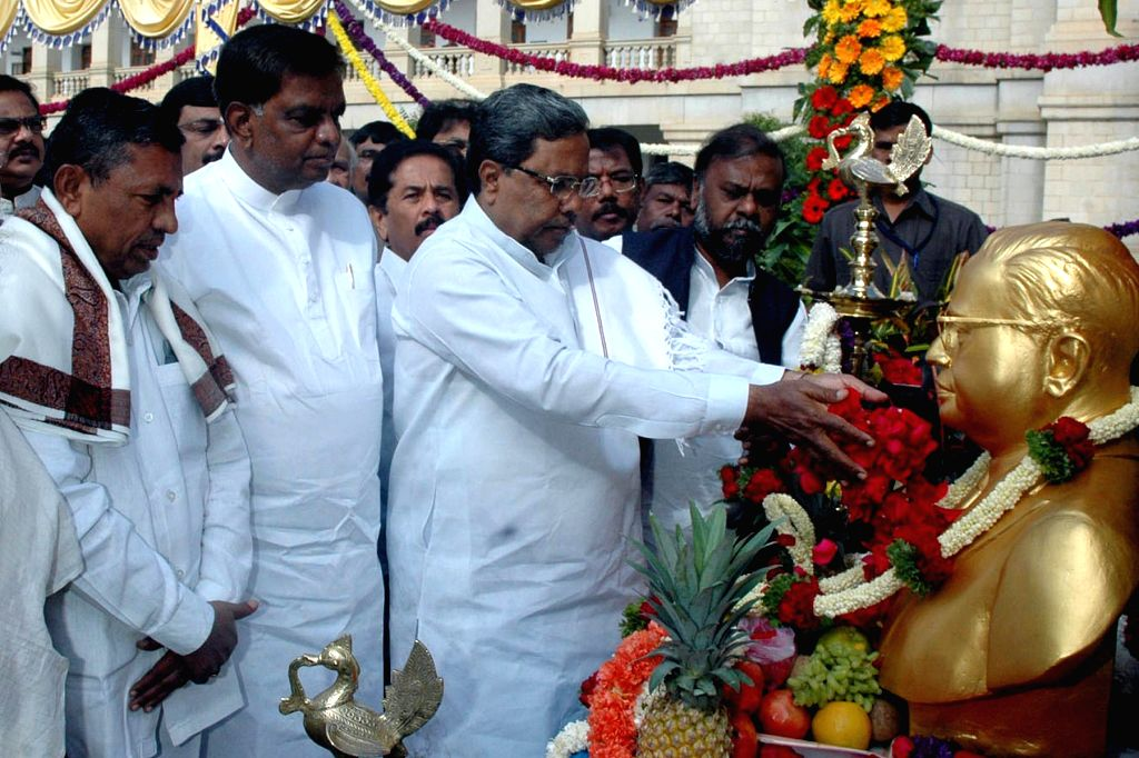 Karnataka Chief Minister Siddaramiah with other leaders offering floral tribute at the statue of Baba Saheb Dr. BR Ambedkar on the occasion of his `Mahaparinirvan Diwas` in Bengaluru on ... - Siddaramiah