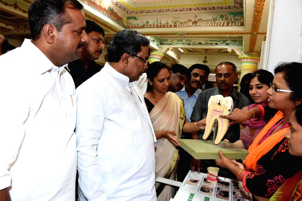 Karnataka Chief Minister Siddaramiah with Karnataka Health and Family Welfare minister U T Khader during the inauguration of the Dantha Bhagya Scheme, at Vidhana Soudha, in Bengaluru on ... - Siddaramiah