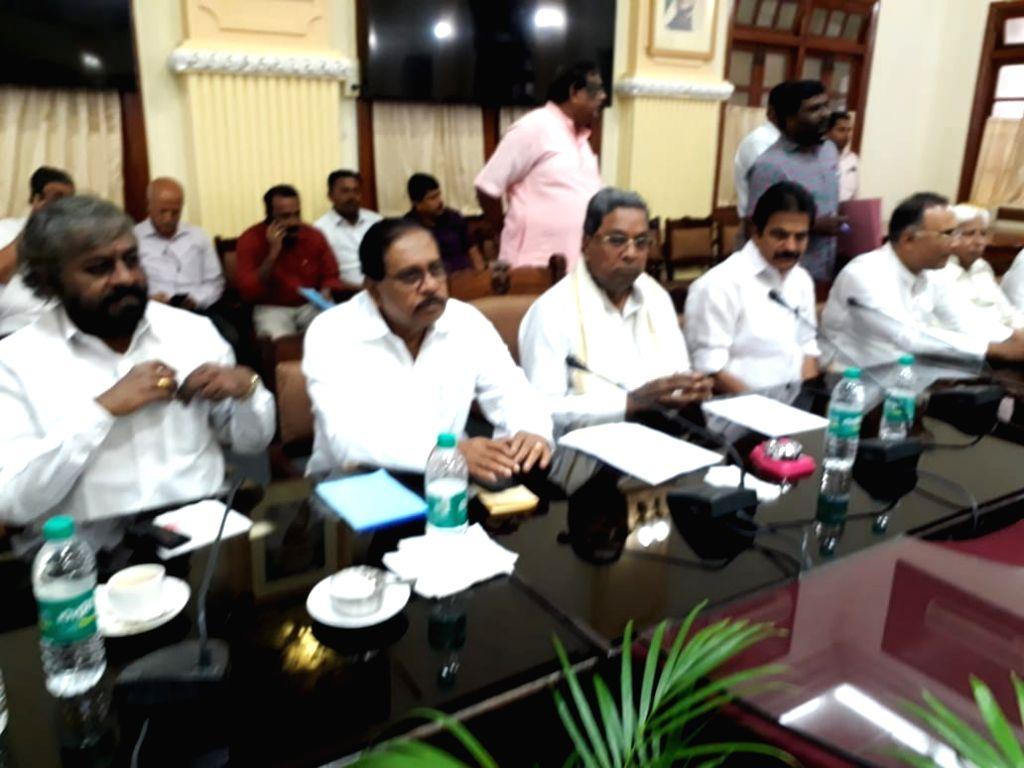 Bengaluru: Karnataka Deputy Chief Minister G Parameshwara and Congress leaders Siddaramaiah, K. C. Venugopal and Dinesh Gundu Rao during Congress Legislature Party (CLP) meeting at Vidhana Soudha in Bengaluru, on July 9, 2019. (Photo: IANS) - G Parameshwara and Dinesh Gundu Rao
