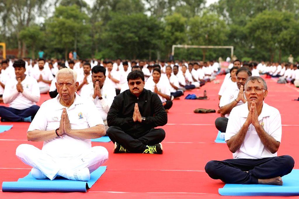 Bengaluru: Karnataka Governor Vajubai Vala and Bangalore University Vice Chancellor Prof. K.R. Venugopal practice yoga asanas - postures - on the 5th International Yoga Day, in Bengaluru on June 21, 2019. (Photo: IANS)