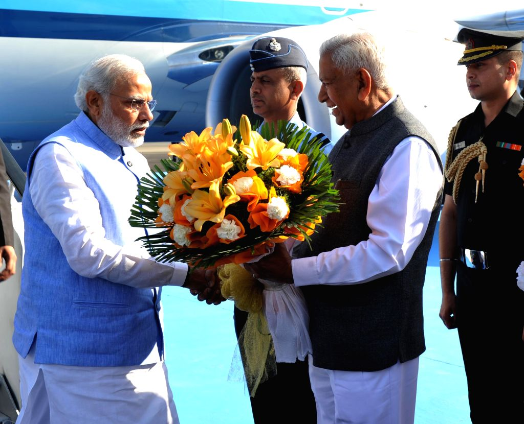 Karnataka Governor Vajubhai Rudabhai Vala receives Prime Minister Narendra Modi on his arrival at Yelahanka Air-force Station, in Bengaluru on Feb 18, 2015. - Narendra Modi