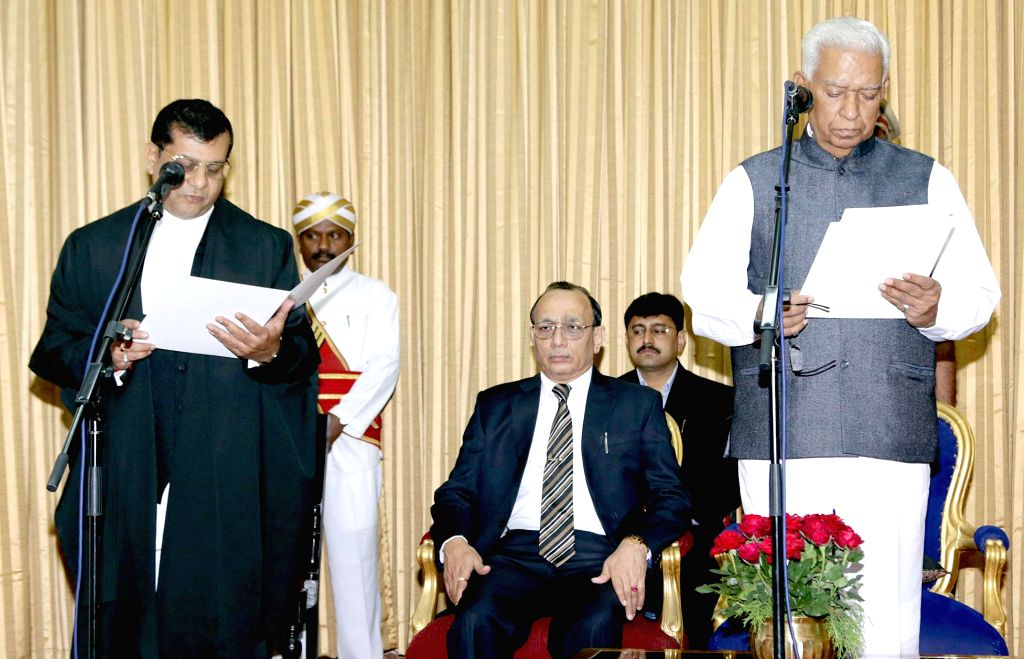 Karnataka Governor Vajubhai Rudabhai Vala administers oath to Karnataka High Court Judge designate Justice Raghavendra Singh Chauhan during his swearing ceremony in Bengaluru on March 10, ... - Raghavendra Singh Chauhan