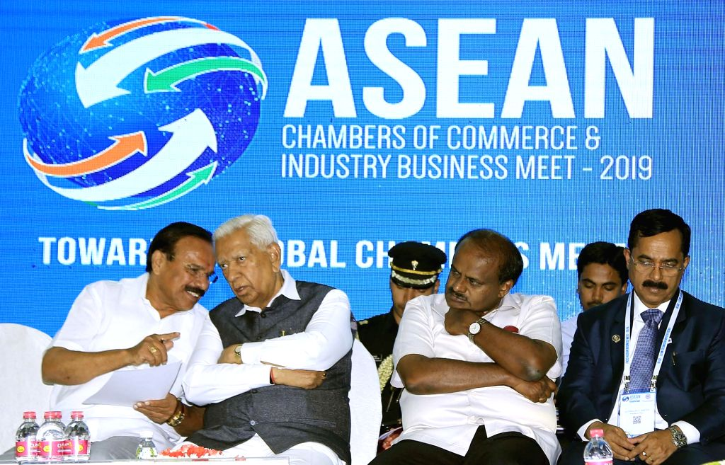 "Bengaluru: Karnataka Governor Vajubhai Rudabhai Vala and Chief Minister HD Kumaraswamy during inauguration of ""ASEAN Chambers of Commerce and Industry Business Meet - 2019"" in Bengaluru on Feb 25, 2019. (Photo: IANS) - H"