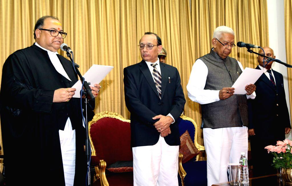 Karnataka Governor Vajubhai Rudhabhai Vala administers oath of office to Justice Subhro Kamal Mukherjee - as a judge of Karnataka High Court - at Raj Bhavan in Bengaluru, on April 15, ...