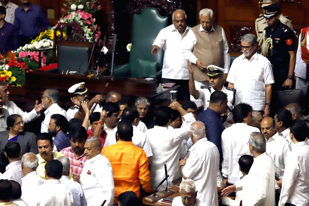 Bengaluru: Karnataka Governor Vajubhai Vala and state assembly Speaker K. R. Ramesh Kumar look on as BJP MLAs create ruckus during the state assembly's Budget Session, in Bengaluru on Feb 6, 2019. (Photo: IANS) - K. R. Ramesh Kumar