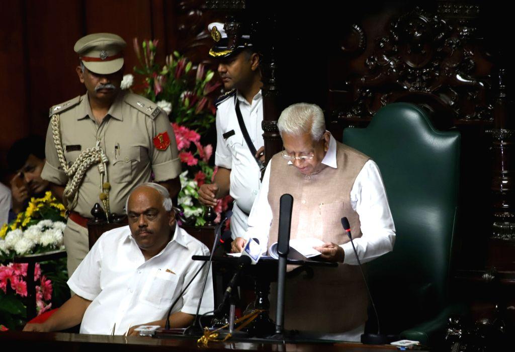 Bengaluru: Karnataka Governor Vajubhai Vala delivers his joint address to the state assembly during the Budget Session, in Bengaluru on Feb 6, 2019. Also seen Karnataka Assembly Speaker K. R. Ramesh Kumar(Photo: IANS) - K. R. Ramesh Kumar